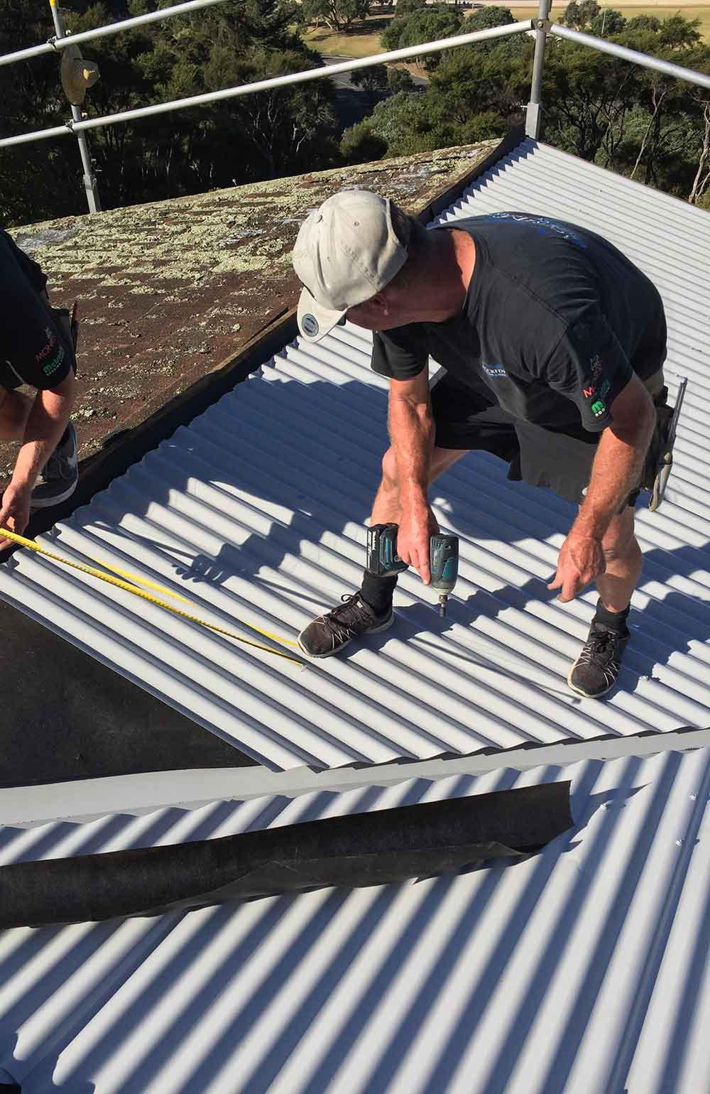 Pic-2-Fixing-the-new-roofing-sheets-with-precision